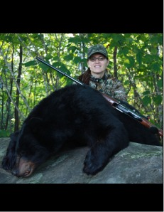 Cheri took her first bear with Wawang Lake Resort on her second day of hunting!