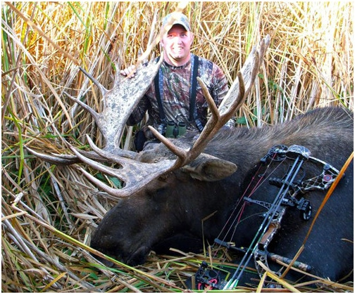 Aaron Folk killed this state record North Dakota moose in October 2012, with a green score of 166 and a 53-inch spread.