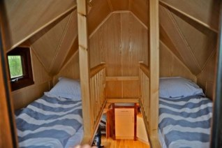 Tinywood home on trailer with built in outdoor hot tub Small house heating systems